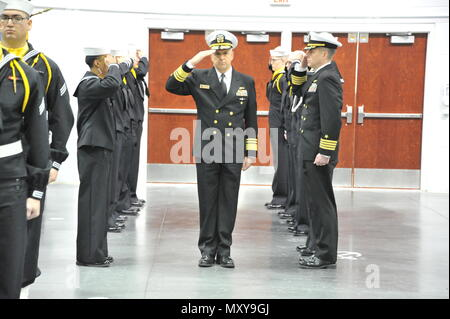 161216-N-CM124-129  GREAT LAKES, Ill. (Dec. 16, 2016) Chief of Naval Personnel Robert P. Burke is introduced to the guests at the Pass-In-Review ceremony Dec. 16 at Midway Ceremony Drill Hall, Recruit Training Command. Burke served as the ceremony's reviewing officer where just over 940 recruits graduated from the Navy's only boot camp.  (U.S. Navy photo by Susan Krawczyk/Released). - Stock Photo