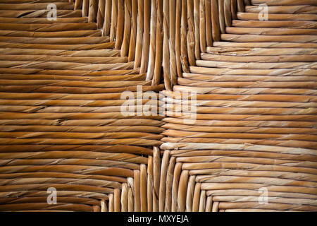 Wicker furniture. Wickerwork. Close up of rush Seat. Vintage chair. Handmade Traditional Antique Craft. Natural materials. Rustic Country Made. Straw  - Stock Photo