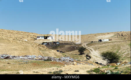 Jahalin Bedouin villages scattered along the main road to the Dead Sea. Many of the Bedouins lost their land and they reside in simple caravans & tent - Stock Photo
