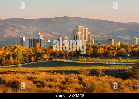 Sunset over the Reno, Nevada skyline as seen from Rancho San Rafael Park in North West Reno, USA - Stock Photo