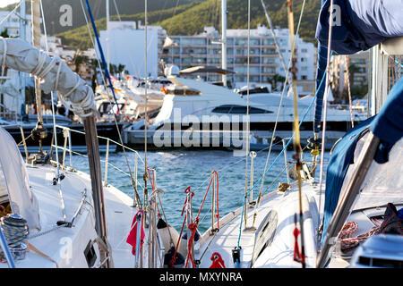 Moored boats in the port of Santa Eulalia. Santa Eulalia is a beautiful town and resort on the East coast of the Ibiza island. Balearic Islands, Spain - Stock Photo