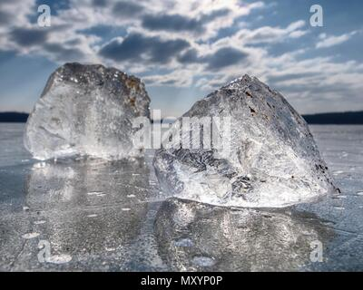 Shining broken ice. It beautifully shimmers the sun's rays, plays light and glare - Stock Photo