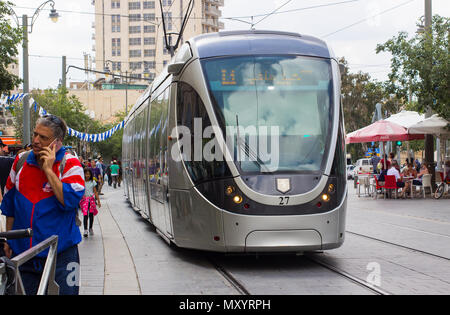 9 May 2018 An electric powered tram on the modern light rail system that forms a vital part of the travel network in the city of Jerusalem Israel. - Stock Photo