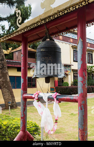 Namdrolling Monastery ornate bell with letters engraved on it at entrance in Coorg Karnataka - Stock Photo