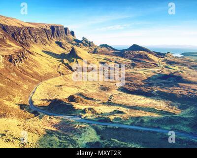 Quiraing mountains sunset at Isle of Skye, Scottish highlands. Tourist hiking around  romantic green valley - Stock Photo