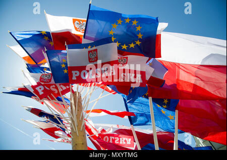 EU and Polish national flags in Warsaw, Poland. May 12th 2018 © Wojciech Strozyk / Alamy Stock Photo - Stock Photo