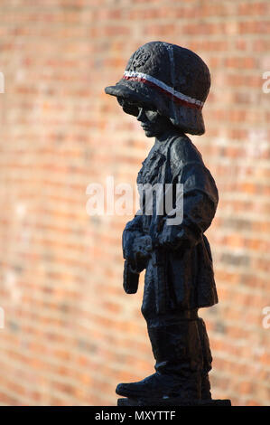 The monument of the Little Insurgent (Pomnik Malego Powstanca) in Warsaw Old Town, Warsaw, Poland. May 12th 2018. The statue is a homage to the child  - Stock Photo