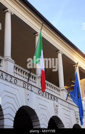 'Broletto' palace with Italian and city flags. Built in the 13th century. Now the seat of the provincial administration. Brescia, Italy. - Stock Photo