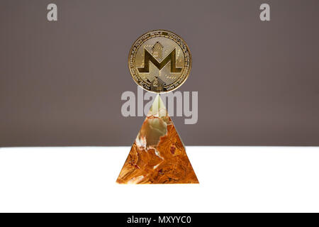 A Monero Coin sitting a top a translucent Onyx Stone. Stone symbolizes, personal power, change, facing fears. All things people who trade crypro face - Stock Photo