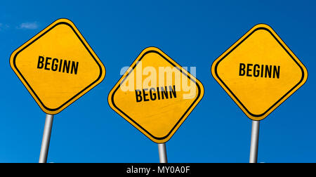beginn - yellow signs with blue sky - Stock Photo