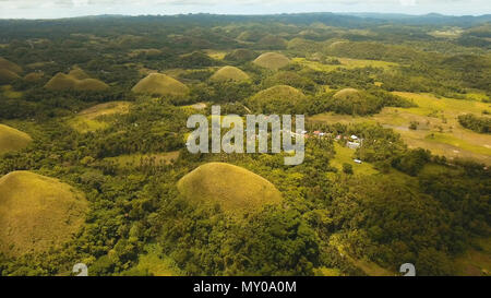 Amazingly shaped Chocolate hills on sunny day on Bohol island, Philippines. Aerial view Chocolate Hills in Bohol, Philippines are earth mounds scattered all over the town of Carmen. Travel concept. - Stock Photo