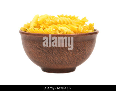 Uncooked pasta fusilli in a bowl on white background - Stock Photo