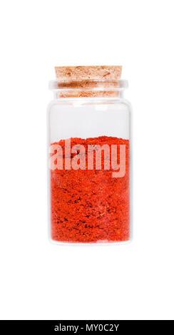 Powdered pimienta roja red pepper in a glass bottle with cork st - Stock Photo