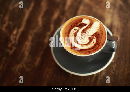 Cup of cappuccino with swan latte art - Stock Photo