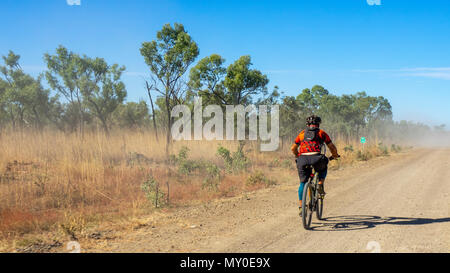 A cyclist riding a mountain bike in the Gibb Challenge 2018 on the Gibb River Road Kimberley WA Australia - Stock Photo