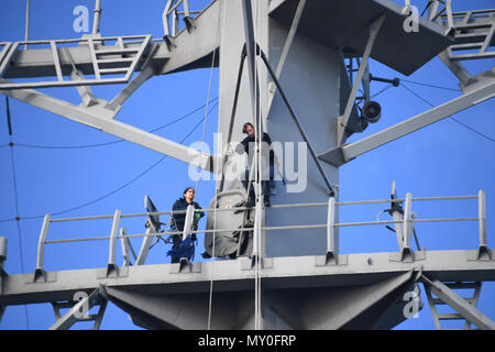161219-N-JI086-074 - VALENCIA, Spain (Dec. 20, 2016) Petty Officer 2nd Class Regina Turnini, left, and Chief Petty Officer Victoria Hobgood work aloft aboard the guided-missile destroyer USS Porter (DDG 78) as it sits pier-side in Valencia, Spain, Dec. 20, 2016. Porter, forward-deployed to Rota, Spain, is conducting naval operations in the U.S. 6th Fleet area of operations in support of U.S. national security interests in Europe. (U.S. Navy photo by Seaman Ford Williams/Released) - Stock Photo
