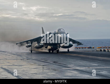 161219-N-BD308-046 ATLANTIC OCEAN (Dec. 19, 2016) An AV-8B Harrier from the 22nd Marine Expeditionary Unit (MEU) launches off the flight deck of the amphibious assault ship USS Wasp (LHD 1). Wasp is deployed as part of the Wasp Amphibious Ready Group, which is offloading the 22nd MEU after completing a six-month deployment to the U.S. 5th and 6th Fleet areas of operations. (U.S. Navy photo by Seaman Levingston Lewis/Released) - Stock Photo
