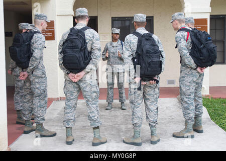 Master Sgt. Kelli Jackson (center), 558th Flying Training Squadron military training leader and superintendent, speaks with basic sensor operator technical training Airmen at Joint Base San Antonio-Randolph Dec. 14, 2016. Jackson wears a blue aiguillette, or rope, on her left shoulder to signify her as an MTL. (U.S. Air Force photo by Airman 1st Class Lauren Parsons/Released) - Stock Photo