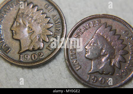 The head side of two 1902 Indian head pennies. - Stock Photo