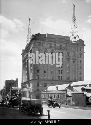 Family Services Building, George Street, Brisbane, September 1926. From the Queensland Heritage Registerid=600111 ) .  Brisbane's first high-rise government office building was constructed between 1914 and 1922. It was intended partly as general public offices, but more importantly as state headquarters for the enormously successful Queensland Government Savings Bank, established in 1864.  Bank headquarters had occupied a purpose-designed banking chamber and offices in the second wing of the Treasury Building from early 1893. By 1912 these premises were no longer adequate. In consequence, the  - Stock Photo