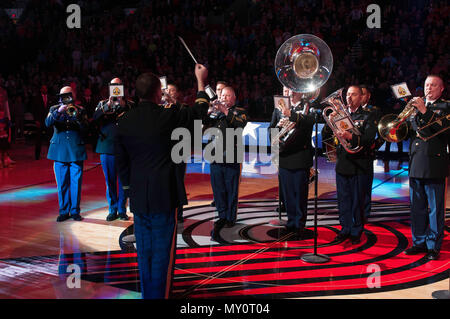 Chief Warrant Officer 4, Russell Houser, band director of the 56th Army Band, leads the playing of the national anthem on Veterans Day Nov. 11, 2016, in Portland, Ore. (U.S. Army photo by Sgt. Youtoy Martin, 5th Mobile Public Affairs Detachment) - Stock Photo