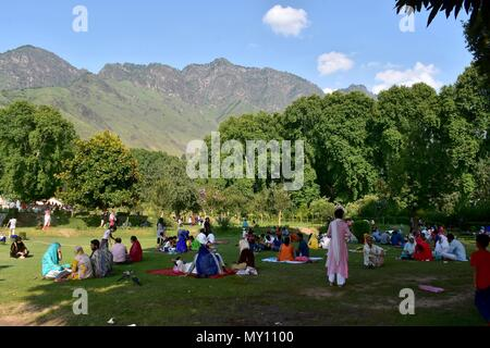 People enjoy under the shades of chinar trees at a famous Mughal ...