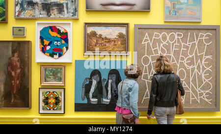 London, UK.  5 June 2018. Visitors to one of the vividly coloured galleries at the preview of the 250th Summer Exhibition at the Royal Academy of Arts in Piccadilly, which has been co-ordinated by Grayson Perry RA this year.  Running concurrently, is The Great Spectacle, featuring highlights from the past 250 years.  Both shows run 12 June to 19 August 2018. Credit: Stephen Chung / Alamy Live News - Stock Photo