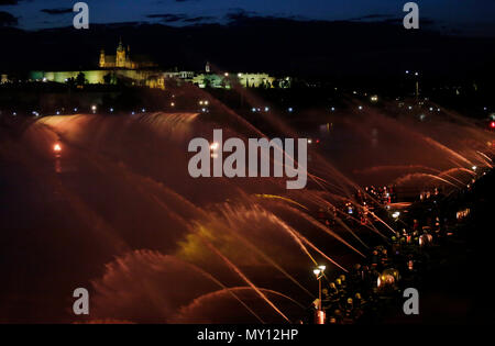 Some 1,000 firefighters from across the country create a musical fountain on the Vltava River (Moldau) in Prague, on Saturday, June 2, 2018, to celebrate the 100th anniversary of Czechoslovakia's establishment. The fountain was be formed by both professional and voluntary firefighters using approximately 200 hose nozzles above the river in the centre of Prague, between Jirasek and Palacky bridges. 'A light concert' and 'a water ballet' using several thousand cubic metres of water was orchestrated in a single moment. Music as well as colour lights accompany the fountain. The Vltava symphonic po - Stock Photo