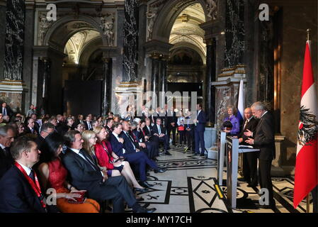 VIENNA, AUSTRIA - JUNE 5, 2018: Austria's President Alexander Ven der Bellen (R), the President of Russia, Vladimir Putin (2nd R), the Director General of Vienna's Kunsthistorisches Museum, Sabine Haag (3rd R), Former Chancellor of the Federal Republic of Germany, Chairman of the Shareholders' Committee at Nord Stream AG, Gerhard Schroder (3rd L front row), Austria's Federal Minister for Digital and Economic Affairs Margarete Schrambock (4th L front row), Austria's Minister of Foreign Affairs, Karin Kneissl (5th L front row), and Austria's Chancellor Sebastian Kurz (6th L front row) at an exhi - Stock Photo