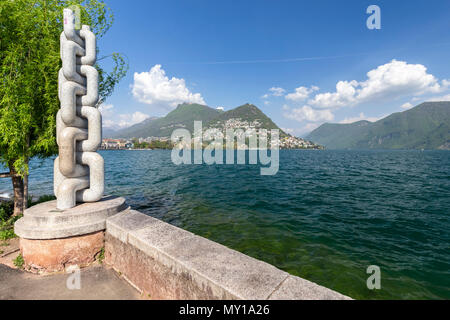 View of Lugano lakefront on a spring day, Canton Ticino, Switzerland. - Stock Photo