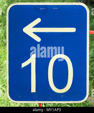 The number ten on a blue metal plate with a white arrow pointing to the left, germany - Stock Photo