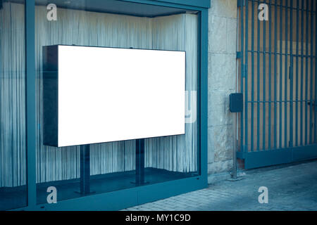 Blank white banner in showcase on the street, mock up - Stock Photo
