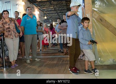 Chisinau, Moldova, people waiting in the arrivals hall of Chisinau airport - Stock Photo