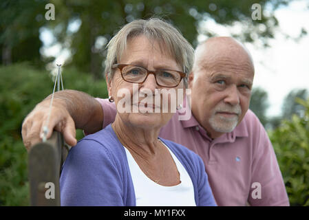 Close up portrait of a western elderly couple still very much in love and together after 50 years of marriage - Stock Photo