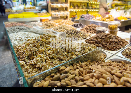 Different types of nuts, almond, walnut in the market. Mahane Yehuda, Jerusalem, Israel - Stock Photo