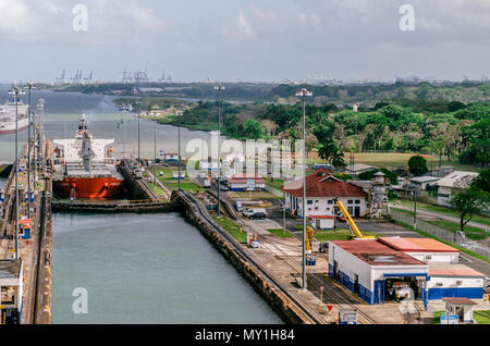 Panama City, Panama - February 20, 2015: Oil tanker ship entering the Miraflores Locks in the Panama Canal, Ships are raised above sea. - Stock Photo