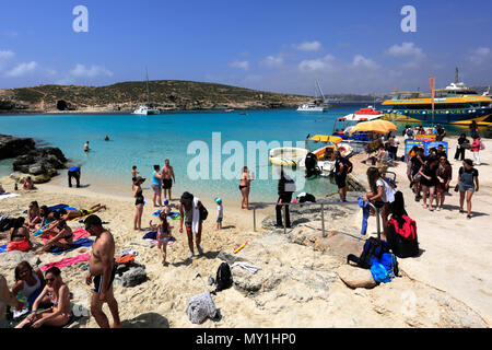 Summer view over the Blue Lagoon, one of the best beaches in Malta, on the island of Comino. - Stock Photo