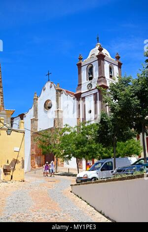View of the Gothic cathedral (Igreja da Misericordia) in the town centre with tourists enjoying the sights, Silves, Portugal, Europe. - Stock Photo