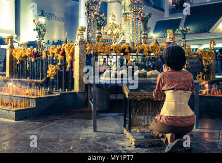 Thailand Woman Kneel In Front Four Face Buddha - Stock Photo