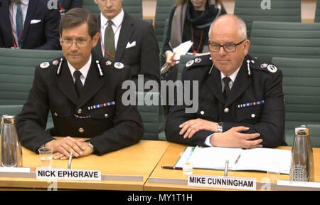 Chief Constable Nick Ephgrave of the National Police Chief's Council (left) and College of Policing chief executive, Mike Cunningham, gives evidence to the Commons Justice Committee at the Palace of Westminster, London, on disclosure of evidence in criminal cases. - Stock Photo