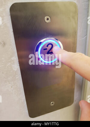 Finger about to presses the elevator button background, Elevator in a building pressing button - Stock Photo