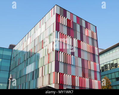 MILAN ITALY OCTOBER 13, 2017 Modern exterior of a bright & colorful office building in Milan, Italy in blue sky background, Beautiful & colorful windo - Stock Photo