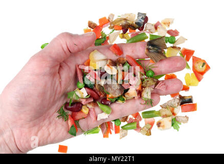 Cook your hand sorting miniature pieces of food waste so as not to throw away the good ones. Isolated on white studio macro  concept - Stock Photo