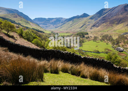 View up Nant Ffrancon valley towards Glyderau mountains of Snowdonia National Park (Eryri) in summer. Bethesda, Gwynedd, North Wales, UK, Britain - Stock Photo