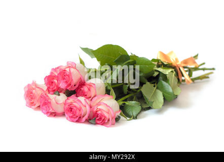 Beautiful bouquet of beige roses with a pink border, bandaged with cream ribbon, isolated on white background - Stock Photo