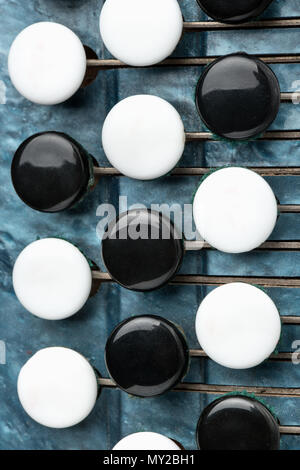 Black and white keys of an old accordion closeup - Stock Photo