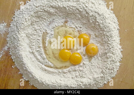 flour and eggs ready to be mixed - Stock Photo
