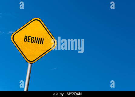 beginn - yellow sign with blue sky - Stock Photo