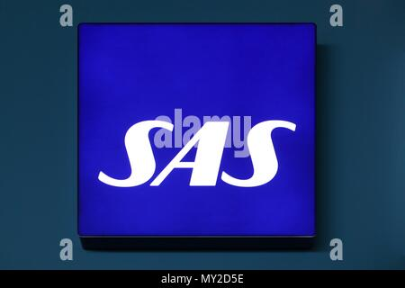Copenhagen, Denmark - May 20, 2018: SAS logo on a wall. Scandinavian Airlines, usually known as SAS, is the flag carrier of Sweden, Norway and Denmark - Stock Photo