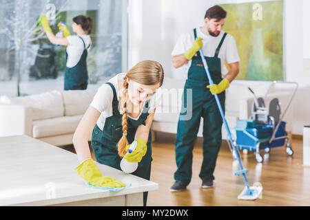 Cleaning service employees with professional equipment cleaning a private home after renovation - Stock Photo